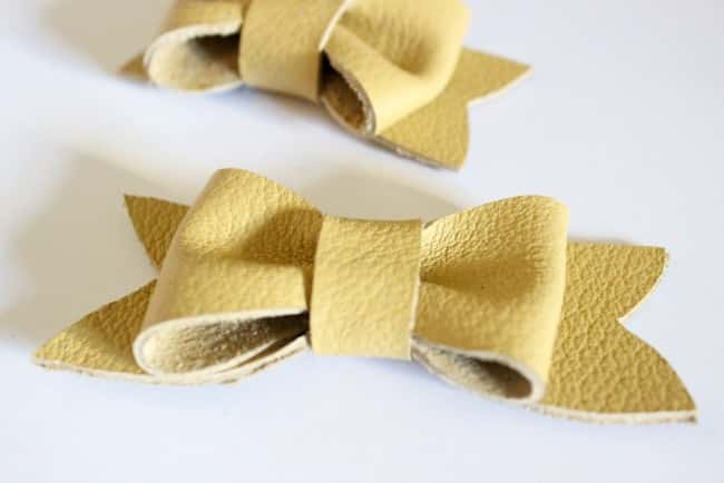 This adorable yellow leather bow is a cute, simple accessory you can make yourself
