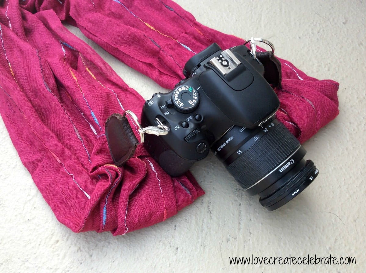 Your camera will look so fashionable with your DIY camera strap made from a scarf!