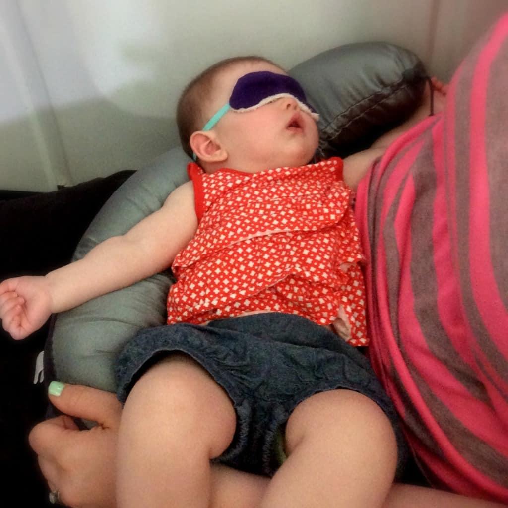 Sleeping on the airplane with the sleep mask