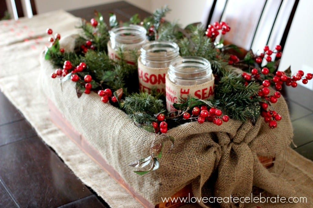 A burlap crate centrepiece with red berries completes the burlap Christmas decorations theme!