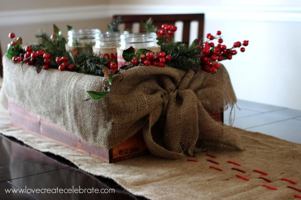 A burlap centrepiece and table runner really add to the burlap Christmas decorations scheme