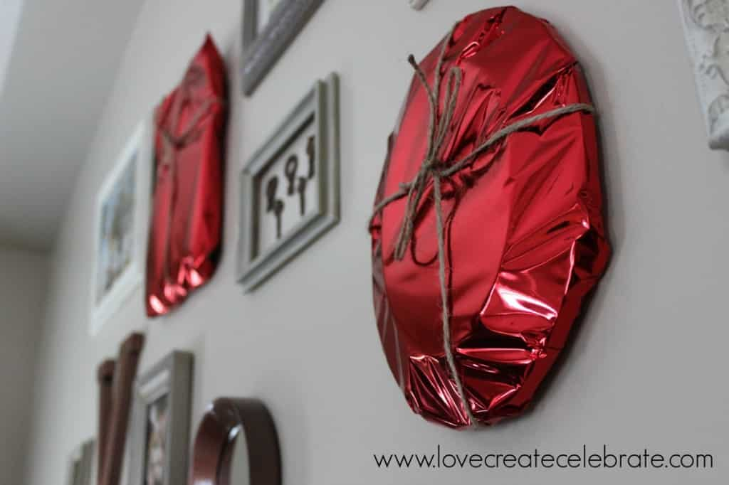 Pictures wrapped in red foil
