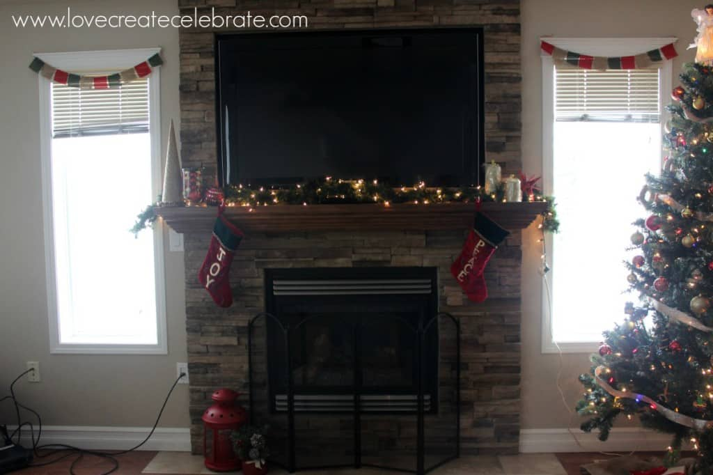 Fire mantlepiece with scattered red & gold decorations