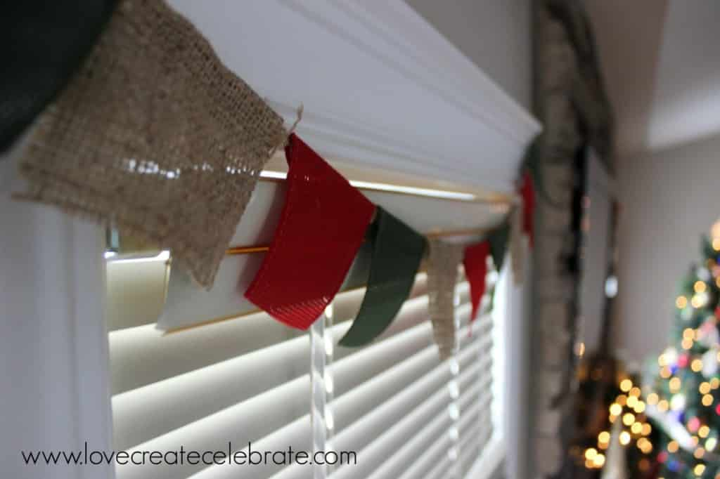 Burlap window garland to add to your burlap Christmas decoration scheme.