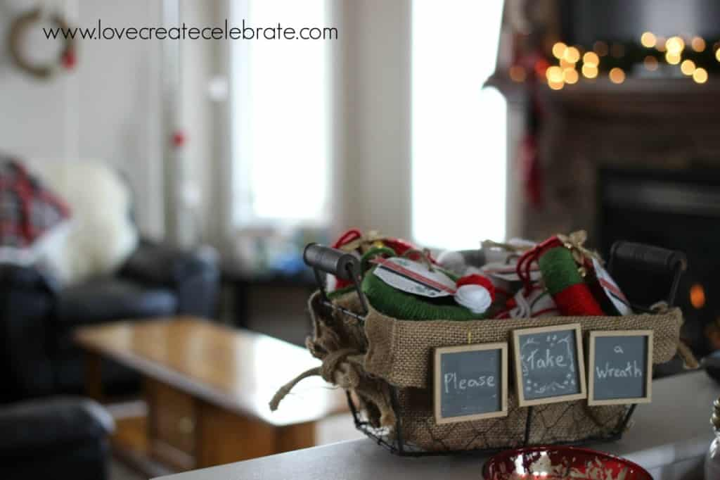 Home-made mini wreaths, inside a burlap Christmas decorations basket.