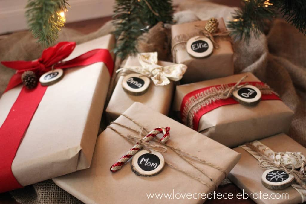 closeup of brown paper wrapped presents underneath Christmas tree