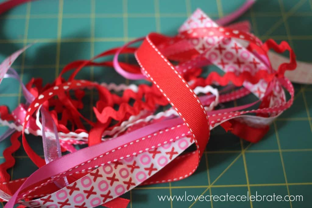 "Cut assorted ribbons into 5"" long pieces."
