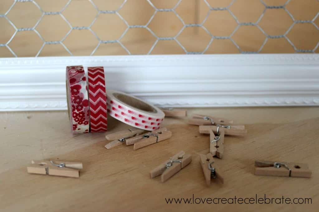 Covering small clothespins with washi tape is a quick and simple way to add colors and patterns to your board.