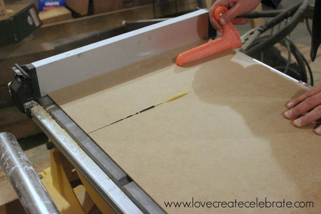 Cut a thick piece of cardboard to use as the backing for the picture frame