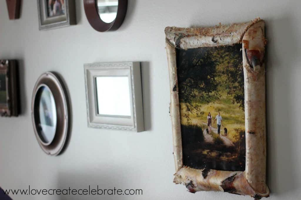 This birch wood picture frame adds a rustic touch to our gallery wall