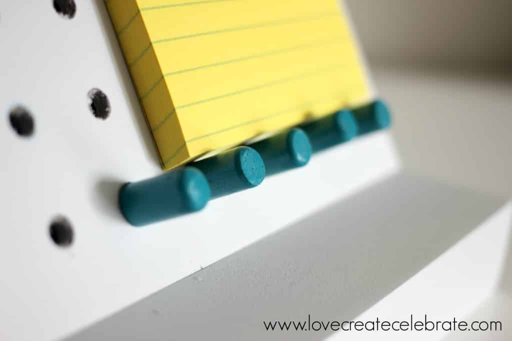 You can move the pegs around to hold and organize whatever desk items you have