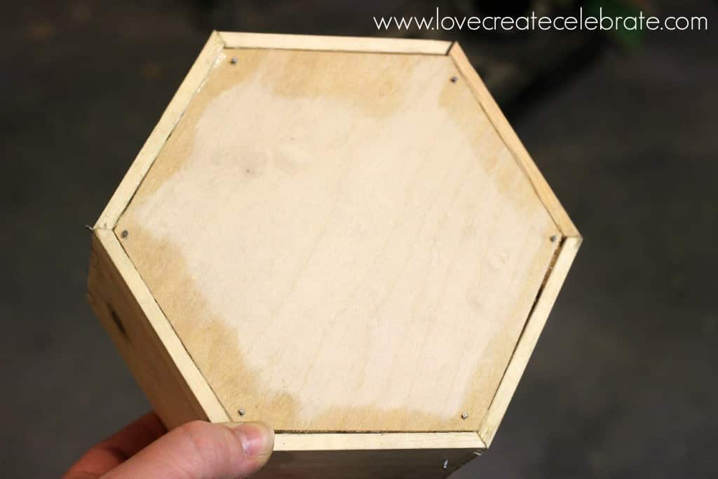 Cut your plywood piece to fit on the front of the hexagon