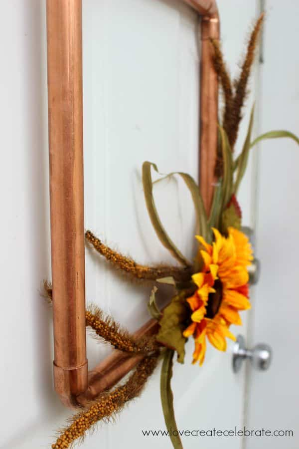 This copper pipe wreath is the perfect touch of fall decor for your home