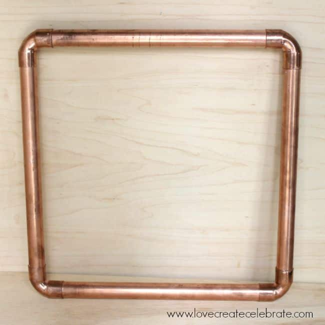 The frame of this wreath is a simple copper pipe frame