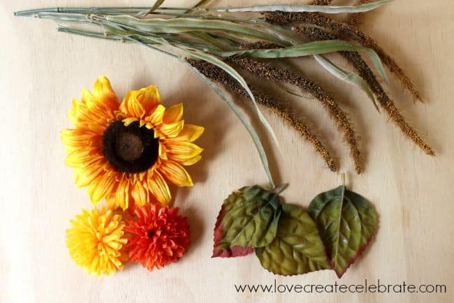 I picked these colorful fall flowers to add to the copper pipe wreath frame