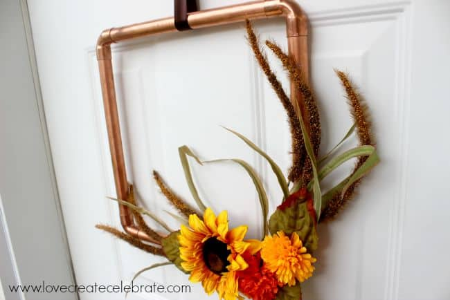Put together this simple copper pipe wreath for a touch of industrial fall decor