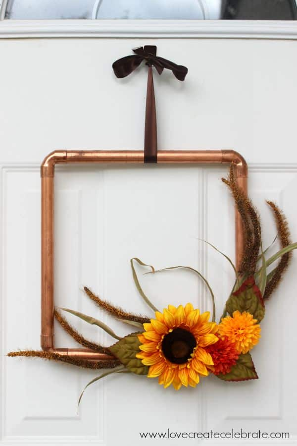 A little industrial style with fall colors, this opper wreath will look great on your front door