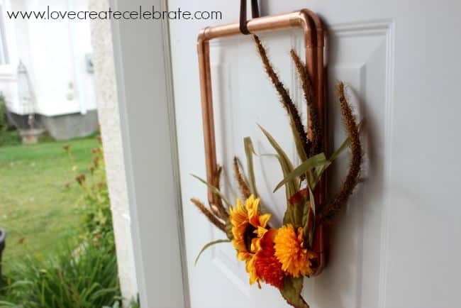 Make this simple DIY fall copper pipe wreath to add color to your fall decor