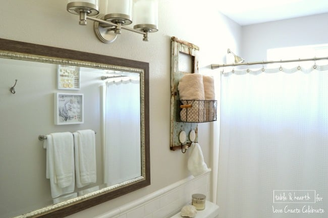 Pretty shabbiness! This blogger took an old piece of wood washed up on the beach and made this adorable rustic towel holder with it!