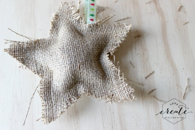 This frayed star burlap ornament is a simple craft that adds a rustic touch to your christmas tree