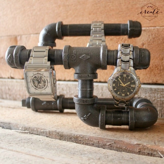 This DIY industrial watch holder made with vintage pipes is unexpected and functional.