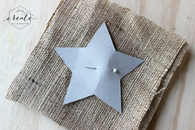 Pin the star template to the burlap so you can sew it in place