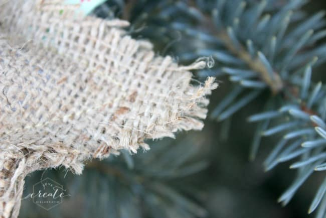 The frayed edges of these burlap ornaments give them a rustic look