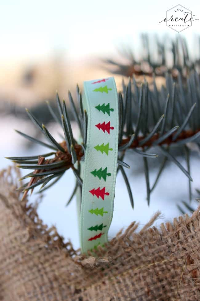 Adding this Christmas tree ribbon to the burlap ornaments makes them easy to hang from your christmas tree