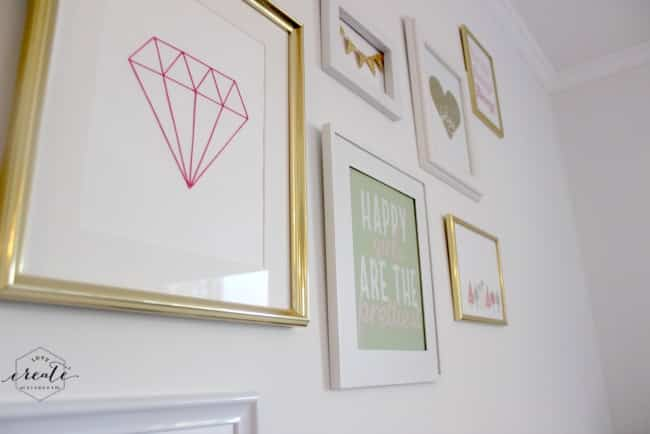 Chic white and gold gallery wall for your daughter's room!