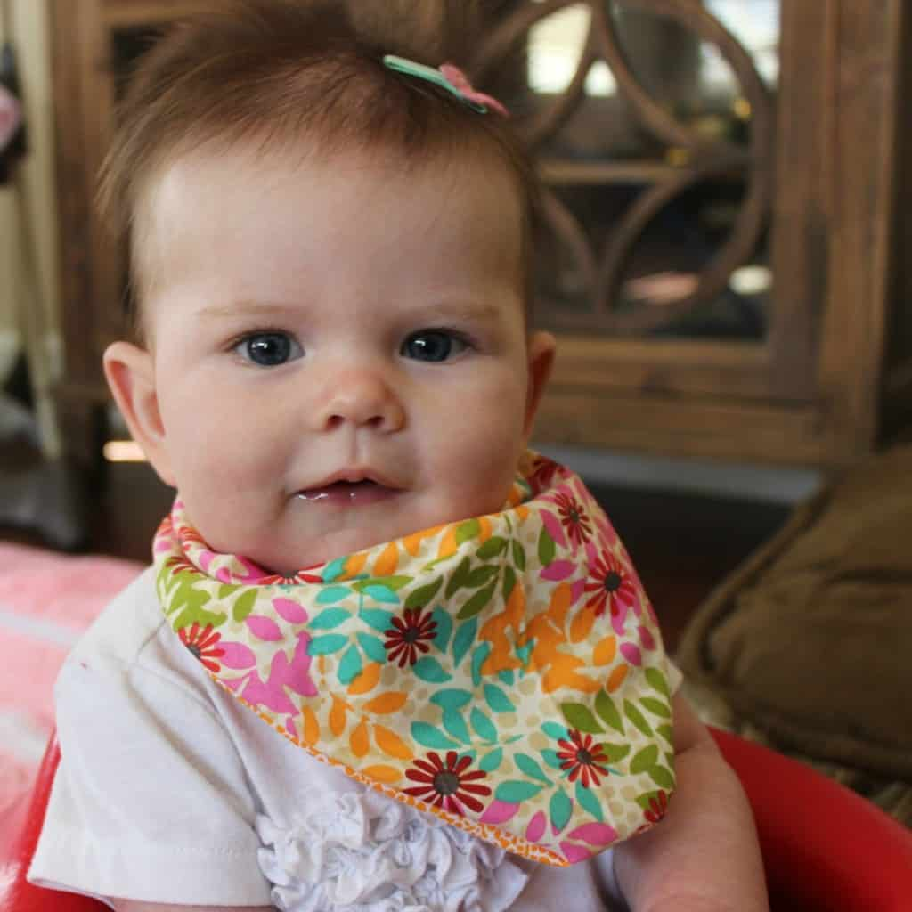 baby bibs are a much needed accessory - make your own with this easy tutorial
