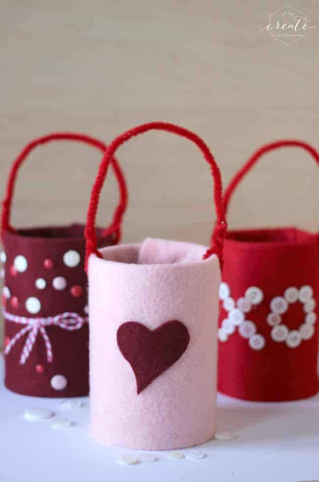 Help the kids decorate their tin can candy holders with glitter, buttons, and felt hearts