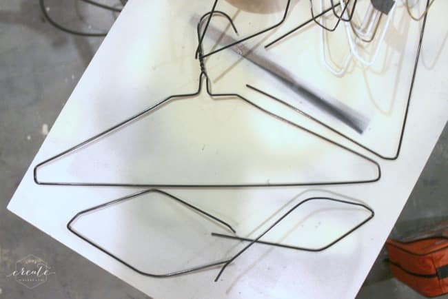 Cut apart the wire hangers and shape them into the sunburst