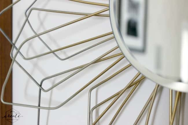 Recycle old wire hangers to create the sunburst effect on this DIY mirror
