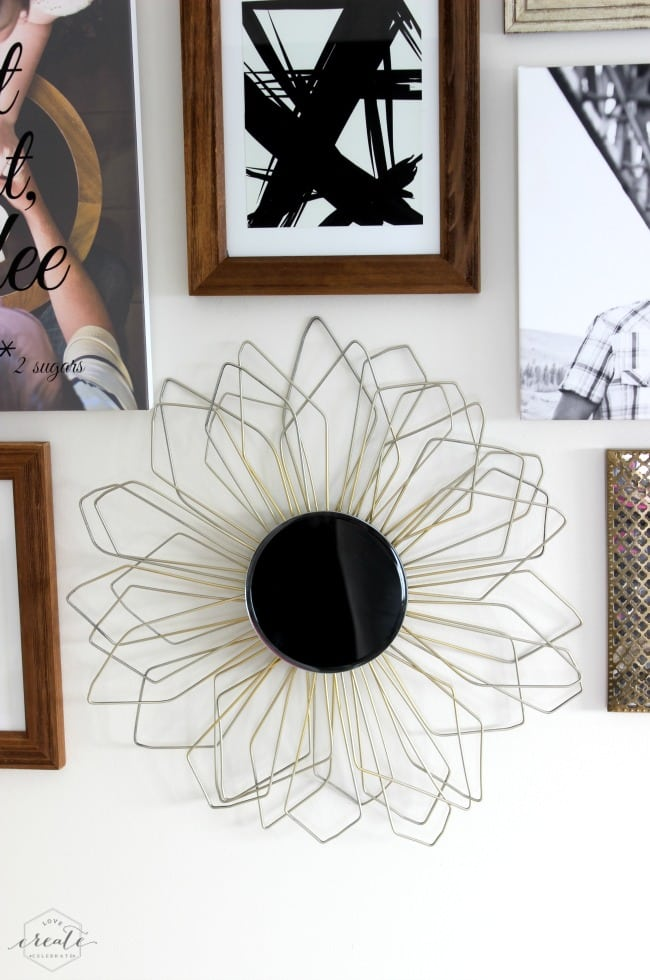 This DIY sunburst mirror is the center of attention on this gallery wall