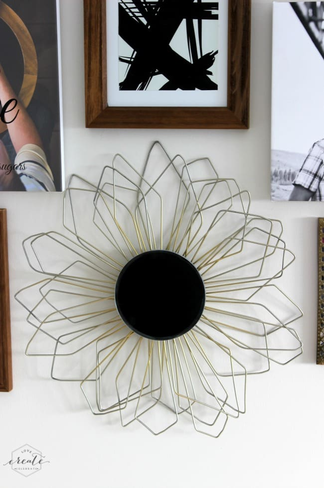 This beautiful DIY sunburst mirror is made with coat hangers and is a modern, stylish decor piece!