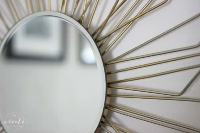 A simple round mirror is the perfect final touch on this DIY sunburst mirror