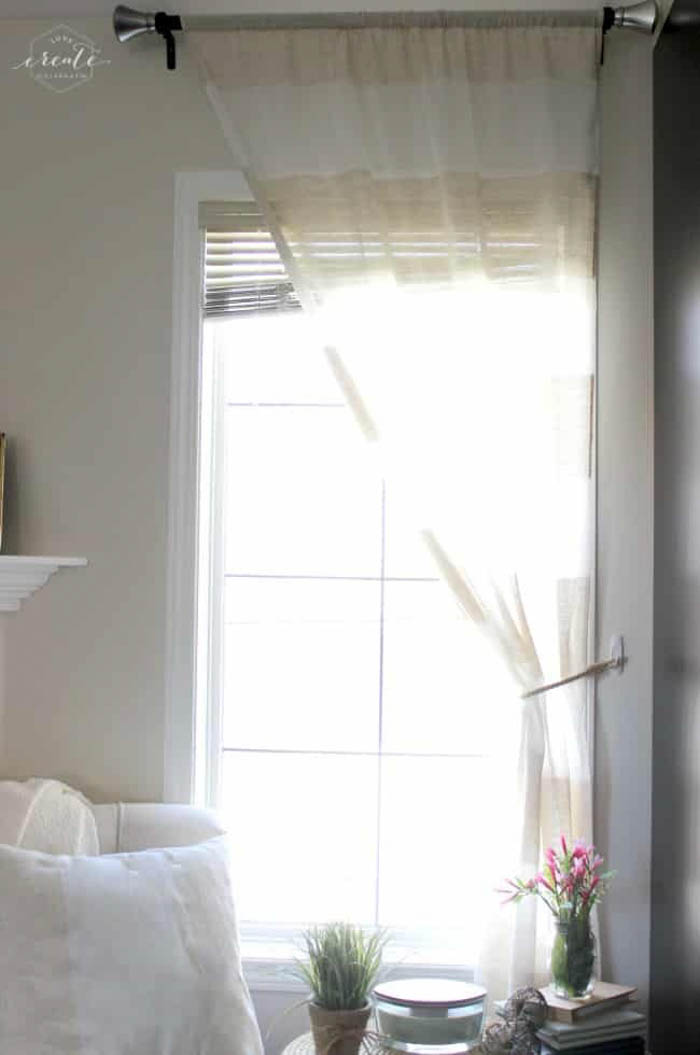 single curtain tied to the side on the window
