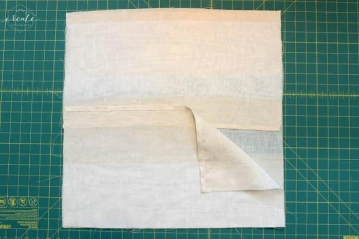 fabric folded over for DIY pillow covers