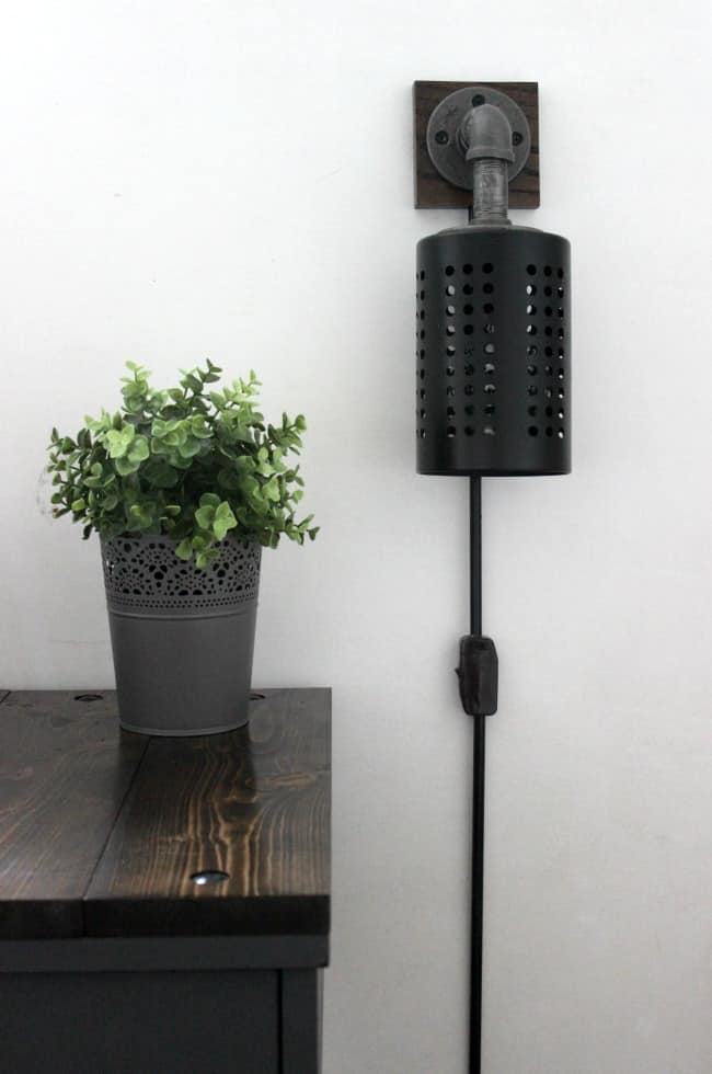 Make your own DIY Industrial Sconces with this great tutorial. We'll tell you everything you need to make a DIY wall sconce! Add character to your room with IKEA hack!