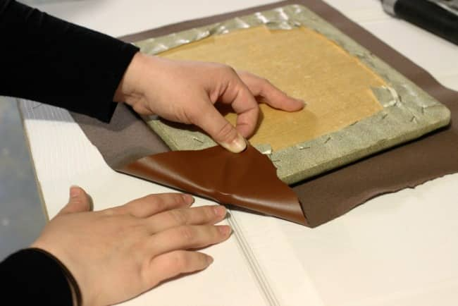 Fold the corner of the faux leather and staple it in place