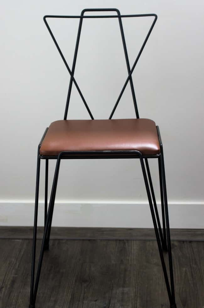I painted the frame of this retro chair a matte black before replacing the cushion