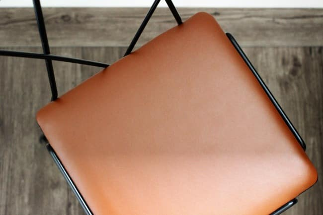 I love the look of this new faux leather upholstered chair cushion! It gives the chair a whole new look