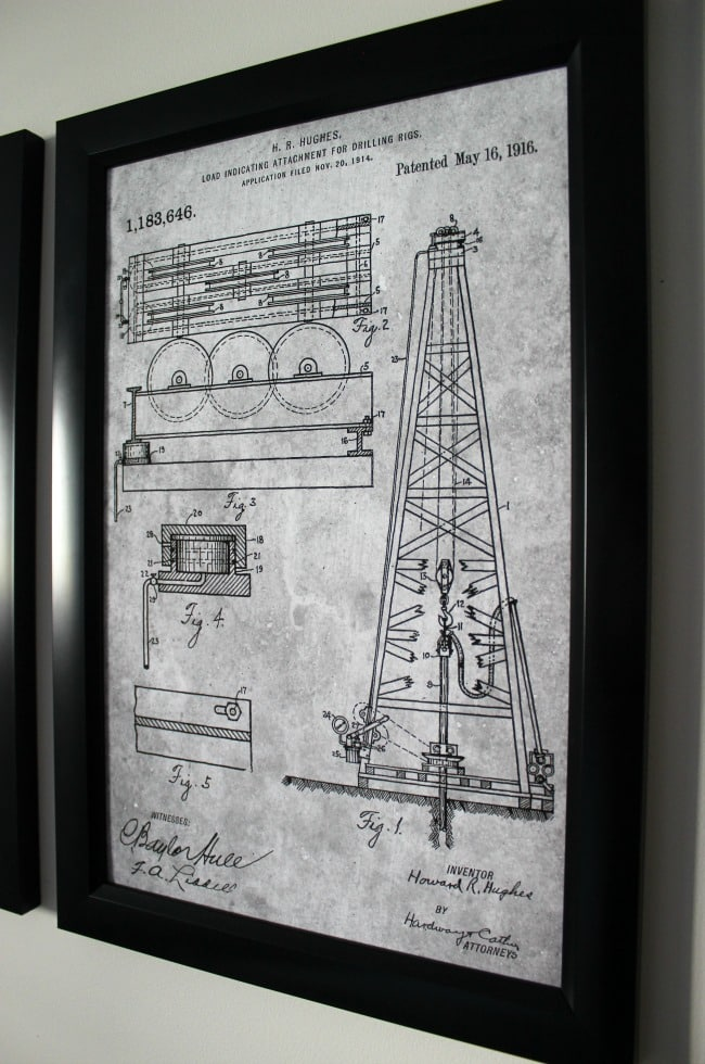 Love the mix of modern and industrial decor in this bedroom design! Beautiful patent prints for the wall!