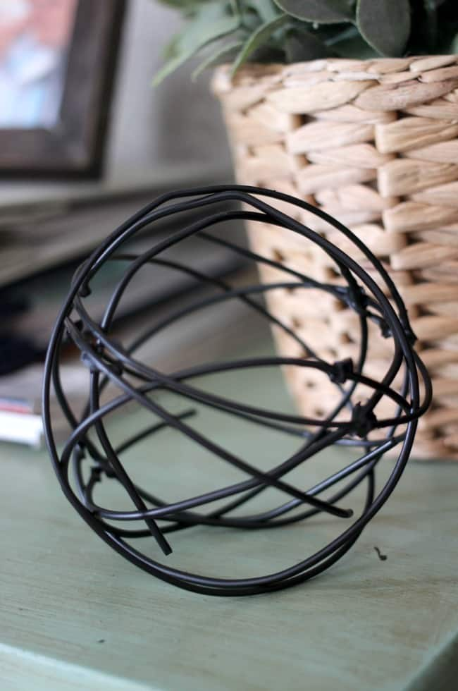 large decorative orb made from old hangers