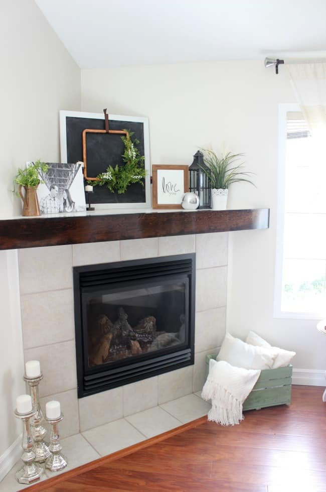 This rustic wooden mantel was an easy DIY project that gave our fireplace a whole new look