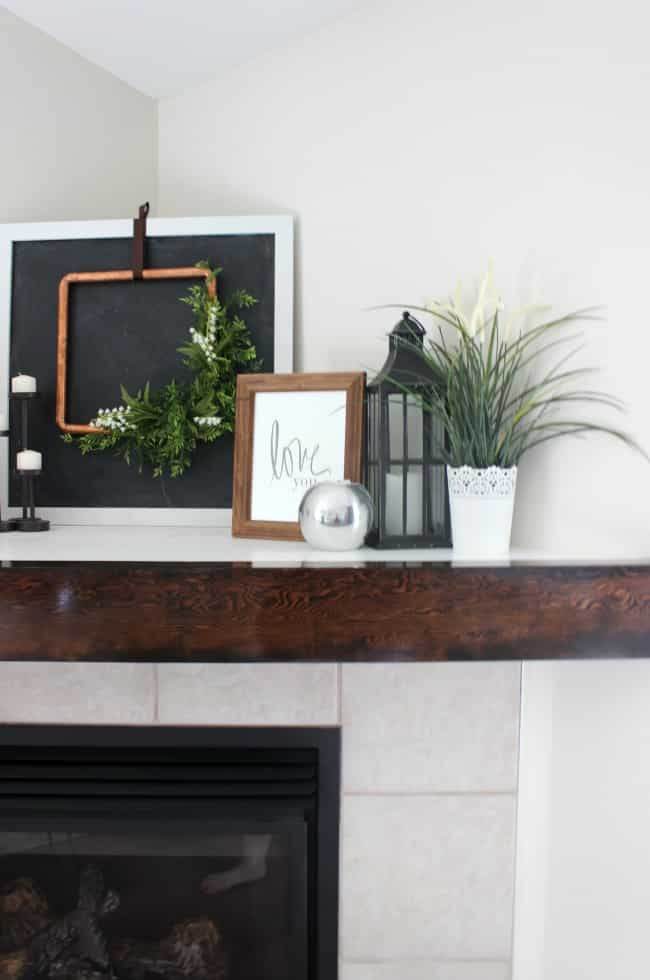 We used a glass varnish on this wooden mantle, but a matte finish would add a nice rustic touch