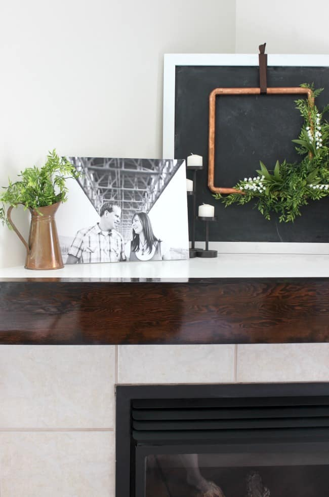 This DIY wooden mantel adds a fresh style to our living room fireplace, and it was a super easy project!