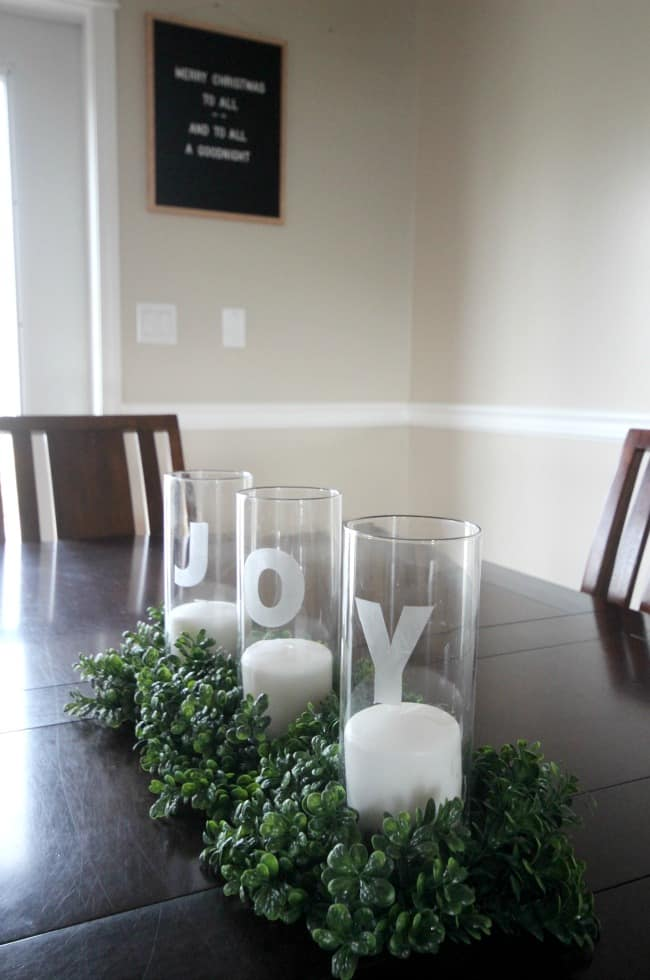 Love the etched glass lettering on this holiday centerpiece. Great idea for your holiday tablescape!
