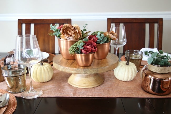 Beautiful inspiration for a fall tablescape! Beautiful ideas for a Thanksgiving Day table too! Love the combination of woods, coppers, and florals.