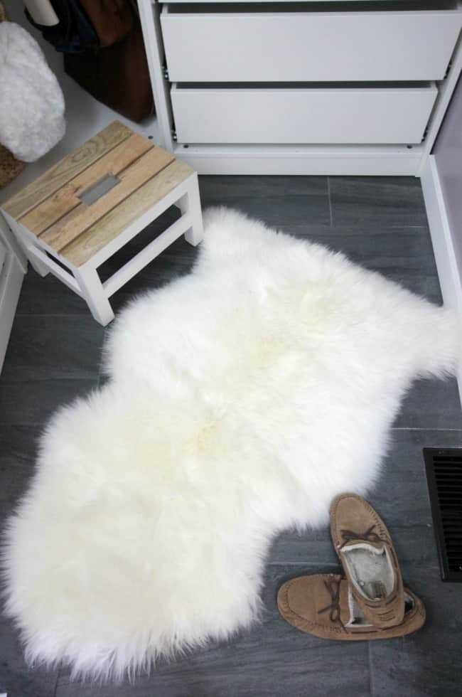 This charcoal tile floor and sheepskin rug look amazing in our new dream closet.